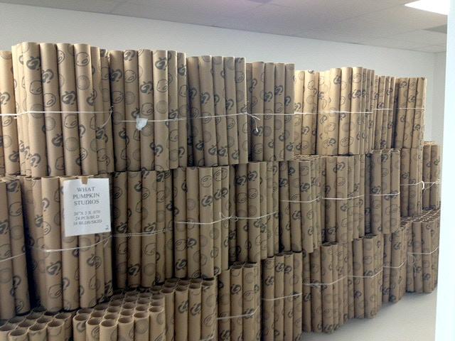 Many prints in cardboard tubes.